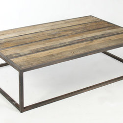 Liesbeth Reclaimed Wood Coffee Table - Reclaimed Oak surrounded by recycled metal make the Liesbeth Coffee Table not only usable but also environmentally sound. The clean lines and sharp corners invoke an industrial feel, however, paired with a cozy deep set sofa, can easily take this furnishing from industrial to rustic. Whatever you choose to accompany the rectangular cocktail table, its sturdy build and unpolished natural feel make it a lovely choice for a loft living room or downtown TV room. Our European Zen Collection combines Old World glamour with rustic simplicity. These fine home furnishings are inspired by classic European style and offer understated elegance. Decorative carved aprons and legs, nail head trim and natural textiles exudes its vintage French appeal while recycled metal and tactile fabrication exudes its effortless chic quality. Add refined charm to both traditional and contemporary interiors with this furniture collection.