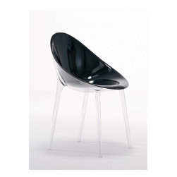 Kartell - Mr. Impossible Side Chair - A most inviting chair with an organic design that inspires comfort, neatness and style, the Mr. Impossible Chair is the combination of sophisticated and advanced plastic processing design. The Mr. Impossible Chair takes on a new technological challenge with highly sophisticated processing techniques that consist of the welding of the transparent structure and the seat into a full-colored and translucent version that are joined together, making them indestructible and guaranteeing a truly surprising design effect. The seal of the two oval shells gives the plastic a new bi-color and three-dimensional effect as it welds a transparent and a colored surface together without interruption. Hollow circular legs support the chair, causing it to appear suspended in the air and giving it an air of lightness and harmony.Designed by: Philippe Starck, 2008 Features: -Seat is made of transparent or batch-dyed polycarbonate material.-Frame is made of transparent polycarbonate.-Hollow transparent legs.-Made in Italy.-In 2005, Kartell received accreditation for its Quality Management Systems according to the ISO 9001: 2000 standard. The attainment and preservation of this certification testifies to Kartell's commitment to high quality and continued research into higher levels of quality in company management systems..-Kartell products use a wide variety of plastic materials, thereby reducing the use of living organisms, such as trees, which are difficult and time-consuming to replace..-Most Kartell products are easily recycled and product components can be separated to elements made of a single material to simplify the recycling process. Plastic components also carry clear identification marks to aid correct separation of different plastic types for effective recycling..-Kartell products are easy to clean and require only simple care to remain in excellent condition. Please see here for specific information on the proper cleaning and use of Karte