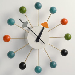 """George Nelson Ball Clock Multi-Color by Vitra - http://www.stardust.com/SEARCH.html?q=nelson+ball+clock   George Nelson Multi-Color Ball Clock: a mid-century modern design classic!  George Nelson often collaborated with other designers, and in the case of the Ball Clock (1948), Nelson was at a dinner party with Isamu Noguchi, Irving Harper and Bucky Fuller. As the story goes, they were all sketching and """"we'd had a little bit too much to drink,"""" said Nelson. In the morning, they saw a drawing of the Ball Clock on a roll of drafting paper. """"I don't know to this day who cooked it up,"""" said Nelson. """"I know it wasn't me. It might have been Irving, but he didn't think so. [We] both guessed that Isamu had probably done it because [he] has a genius for doing two stupid things and making something extraordinary out of the combination. It could have been an additive thing, but we never knew."""" The Ball Clock has been diligently reproduced by the Vitra Design Museum."""