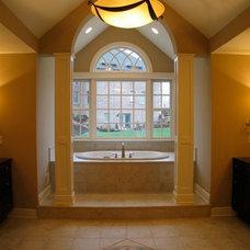 Master Bathroom: beautiful pillars, light fixture, and mosaic work