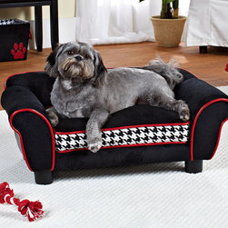 Frontgate - Multicolored Lotus Pet Bed Dog Bed - Durable black polyester microfiber upholstery with red faux-leather cording and a black-and-white houndstooth print on the front of the cushion. Features the SNOOzZzONE™ Pet Comfort System, which includes: a foam insert with a self-warming thermal layer that maximizes the pet's own heat; an insert made of gel squares that provides cooling pressure distribution; and a supportive, dense memory foam insert for pets with hip or back problems. Complementary SNOOzZzONE™ Pet Comfort System is exclusive to Frontgate. Slightly elevated design provides draft-free snoozing. Pocket at back of sofa for storing toys. Our Houndstooth Lotus Bed is more than just a chic piece of pet furniture: it's a customizable sleeping space. The sofa design offers a comforting three-sided bolster that dogs crave, and comes with three specialized cushion inserts so you can provide exactly what your pet needs: extra warmth, cooling pressure distribution, or orthopedic comfort.  .  .  .  .  . High-loft milled foam fill . Furniture-grade construction . Machine-washable polyester microfiber cushion cover . Orthopedic insert made of high-quality visco-elastic polyurethane foam . Polyurethane-base gel insert is non-toxic and free of lead and heavy metals . For pets up to 11 lbs. .