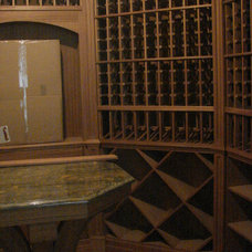 Traditional Wine Cellar by Matthew Korn Architecture AIA