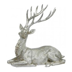 Winward Designs - Reindeer Sitting - Add a sophisticated holiday touch to your home with a metallic reindeer this season. Place him next to the fireplace or on your front porch for a festive bit of decor. What's lacking in a red nose more than makes up for in elegance and grace.