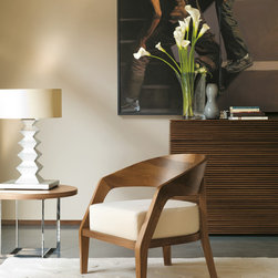 Porada Wood Furnishings - The Porada Alba armchair is crafted with a solid frame in ash. Can be finished in walnut or wenge. Cover is available in a multitude of fabrics and can be removed for easy cleaning.
