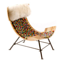Zeeen Relax Chair - The Zeeen Relax chair by Lop Furniture is quirky in shape and in materials: It's finished in pom-poms and wool. It's definitely a unique addition to your home.