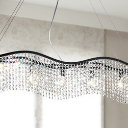 None - Wave 5-light Black and Crystal Chandelier - Give your dining room an elegant makeover with this five-light black and crystal chandelier. This chandelier features an adjustable height and a shimmering crystal shade,providing an exquisite talking piece for when sitting around the dining table.
