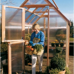 Sunshine - Sunshine Mt. Hood 6 x 8 Foot Greenhouse - GKP68 - Shop for Greenhouses from Hayneedle.com! Additional FeaturesDoor measures 28W x 78H inchesPeak height measures 8.4 feetPanels come preassembledDoes not take long to assembleIncludes printed instructions and an assembly videoComes with a 5-year warrantyThe Sunshine Mt. Hood 6 x 8-Foot Greenhouse allows even those with limited space to enjoy homegrown fresh fruits vegetables plants and flowers. Designed with two vents with automatic openers and Dutch doors you can be sure that there will be plenty of air circulation to help keep your plants healthy. The Dutch doors which also help you to keep small animals out as well as the base are made from recycled plastic. Crafted from beautiful natural and sturdy redwood the preassembled panels are made from twin polycarbonate which helps to protect your plants. The greenhouse measures 8L x 6W x 8.4H feet and comes with printed instructions as well an assembly video.