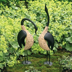 Ancient Graffiti Pair Of Geese Outdoor Sculpture - About Ancient GraffitiKnown for their nature-inspired gifts for the home and garden, Ancient Graffiti takes pride in partnering with artists. They also are aware of the environment and make green choices in their innovative product design. Their artisan partners use and promote sustainable, organic, natural resources. The result is not only beautiful but smart products perfect for your home, indoors and out.
