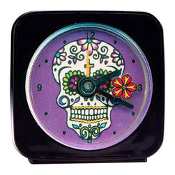"Day of the Dead Alarm Clock - Our alarm clocks add a little whimsy to any room. On our Day of the Dead Alarm Clock, a red flower  floats around the skull as it counts the seconds. This 2.25"" square alarm clock comes in a gift box and includes a free battery. Made in the USA. (Be sure to look for our Day of the Dead magnets, too!)"
