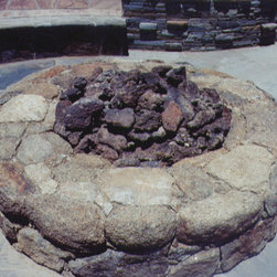 Firepits made with natural stone - natural stone firepit to keep you warm when the weather is a bit chilly