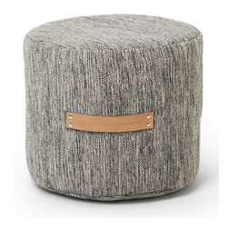 "Design House Stockholm - Bjork Pouf/Stool - Design House Stockholm - The Bjork series and its patterned structure offer a modern and enriched textile quality that is beautifully paired with stylish leather detailing. The designer, Lena Bergstrom's, conviction is that the flat textile surface of a rug is just as natural in the home as stone and wood: ""The [pouf] is a natural part of the Björk collection, just like the stumps in a birch forest. They are a piece of furniture that is light and soft in its expression."" For the Bjork pouf, Lena has drawn inspiration from the rough black and white graphical structure of the birch tree's trunk. The color tones of Bjork create a marbled effect through a warp of cotton intertwined with a weft in wool, known not only for its softness, but also for its in-built resistance to dirt."