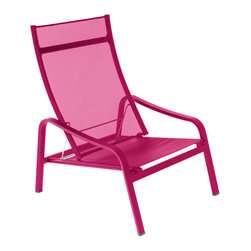 Fermob - Alize Stacking Low Armchair - This modern outdoor chair offers a great way to relax in any outdoor space. Perfect for eating and drinking in the sun, or just chatting with others in a comfortable environment. It's stackable and comes in many beautiful colors.