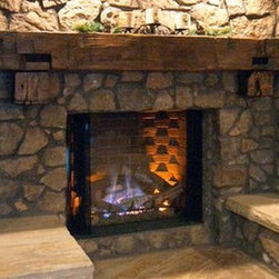 Reclaimed/Salvaged Wood Beam Mantel - This reclaimed barn beam mantle sits on top of two block style timber corbels and gives just the right amount of rustic decor to this living room space.