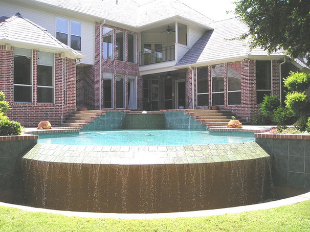 Traditional  by Pool Environments, Inc.