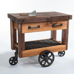Butcher's Block Cart - This Butcher's Block is made from Black Walnut and Red Oak, the handles are hand forged wrought iron, the century old wheel set is from the Lineberry Factory, and the metal grating serving as a shelf is reclaimed from a hammer factory in McMinnville TN. The piece is constructed of solid hardwood, including the drawer slides. The finish is hand rubbed Tung oil which is all natural, food safe, and brings out the true beauty in any piece of wood.