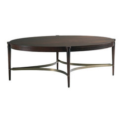 Oval Coffee Table - This elegant coffee table in mahogany with brass stretchers has a sculptural quality that would add style to any room. I love mixing a little bit of brass into every room.