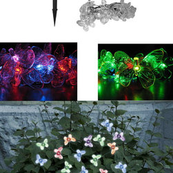 STI - Smart Solar Inc. - Chameleon Color Changing Solar - Solar powered decorative light string. Ideal for decorating shrubs, parasols, and doorways. Powered by a separate amorphous solar panel allowing lights to be placed in shady areas. 20 energy-saving multi color LED's with translucent stylized covers. LED's