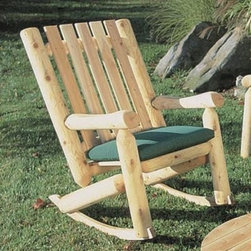 """Rustic Natural Cedar Furniture High Back Rocking Chair - It doesn't get more rustic than this! This Rustic Cedar High Back Rocking Chair is constructed by hand from Northern White Cedar. The design uses the logs to create stability and style. The front legs and support posts use rounded logs while the seat and backrest use finished 5/8 inch thick planks. Very few nails are used for connection as most joints are doweled.The natural occurrence of """"checking"""" or slight cracking adds to the character of the chair WITHOUT affecting its structural integrity. Checking only occurs in the top levels of the wood and does not go past the center of the logs. All surfaces are sanded for an incredibly smooth appealing look and feel. While naturally resistant to weathering you can sustain the original color with a clear varnish or color it with the stain of your choice. If left untreated the wood will weather to a silvery gray.This rocking chair will add a touch of country to any outdoor location. This rustic rocking chair is ideal for the front porch or even in front of the fireplace. Made of Northern White Cedar it is very durable. This type of cedar is naturally resistant to decay and insect damage. It is lightweight and does not shrink or warp like many other woods commonly do. Your beautiful rocker can be stained or sealed or left untreated will naturally weather to a beautiful gray. Ships partially assembled.About Rustic Natural Cedar Furniture Co.Rustic Natural Cedar Furniture Company has been manufacturing quality cedar products for your home and garden for over 30 years. Their broad variety of products include bedroom sets tables and seating groups gliders rockers swings arbors and more. Their fine furnishings are handcrafted in Quebec and British Columbia then shipped worldwide for your enjoyment. The Rustic Natural brand is their promise. When you see this brand you know you're getting superior quality and the strength of natural cedar. Nothing equals the sturdy construc"""