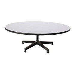 Pre-owned Eames for Herman Miller Revolving Coffee Table - This Eames for Herman Miller Revolving Coffee Table is circa 1960's.  Has white top and black banding.  Rotates 360 degrees.  An icon of design that will raise the bar in any room it graces!