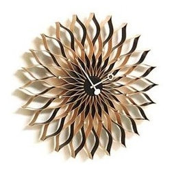 Vitra - Sunflower Clock - Designed in the 1950s, George Nelson's clocks were highly successful both as popular consumer products and icons of high design. One of the most original American designers, Nelson used pure color and bold graphic forms to make a statement still as compelling today as it was half a century ago. The timekeepers are diligently reproduced by the Vitra Design Museum. Powered by one AA battery (included).