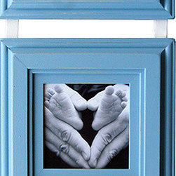 "MyBarnwoodFrames - Baby Picture Frames SetThree 5x5 Baby Blue Frames on Ribbon - Adorable three-frame baby picture frame set in a light baby blue with an ivory hanging ribbon. Holds three 5x5 inch photos. Perfect for your next baby shower gift, this colorful frame set is the perfect way to welcome a new little one into the family. Hang three different portraits, or spell out the word ""boy"" with decorative letters inside each opening. This set is available in several other custom colors. Choose your favorite. Each frame set will include a pre-attached white hanging ribbon you can drape over a picture frame rod, or decorative hook. Or, screw a unique drawer pull into the wall and loop the ribbon over it for a unique photo display. Outside 1/4 inch of your image will be covered by the frame, so allow for a 4.5 x 4.5 viewable opening."