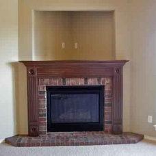 brick-corner-fireplace-with-wood-mantel-end-decor.jpg