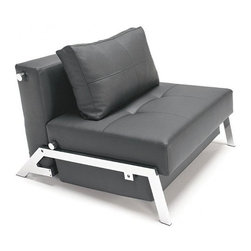 Cube Convertible Lounge Chair - The trick to making a studio apartment work hard for you is filling the space with versatile, multi-use furniture. In addition to being a comfortable chair, this piece also transforms into a twin-sized bed. Compact and innovative, this convertible chair is a must-have in any small space.