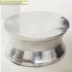 Thimble Metal Coffee Table - This hammered silver table could be the perfect solution. A little more classic and refined than the previous option, it has a metallic finish but in a beautiful organic shape, texture, and no corners for little heads to bump into. Maybe, just maybe, this table will be coming to a living room near me soon.