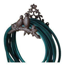 Wrought Iron Bird Hose Holder - This nature inspired cast iron garden hose holder makes a lovely addition to any garden with its classic scrollwork and perched iron birds.