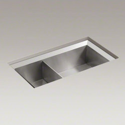 """KOHLER - KOHLER Poise(R) 33"""" x 18"""" x 9-1/2"""" under-mount large/medium double-bowl kitchen - The Poise undercounter sink offers a combination of exceptional functionality and angular design elements, and the large and medium basins feature generous 9"""" depths. Solid, 16-gauge stainless steel construction offers attractive durability while the Mirror finish rim adds eye-catching elegance to the piece. Additionally, exclusive SilentShield(R) sound-absorption technology sharply decreases disposal noise and vibration from dishes and running water for quiet performance."""