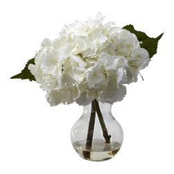 "Nearly Natural - Blooming Hydrangea Arrangement - Includes faux water and glass vase. A light and airy decoration. White color. Vase: 4.5 in. Dia. x 7 in. H. Overall: 10 in. Dia. x 13 in. H""Poof"" says the billowy, delicate Hydrangea. Large Hydrangeas have an almost cloud-like softness to them - you could almost imagine laying down in a bed of them and drifting off to dream world. And we've perfectly captured that feeling in this amazing reproduction. Gorgeous Hydrangeas stems, leaves, and a burst of softness that only the Hydrangea can offer. Makes a perfect gift."