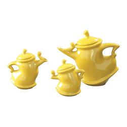 Dancing Teapots - Tea time doesn't have to be a stuffy affair. This set of three canary-yellow teapots might be standing still, but they look like they're dancing across your table. Bring a touch of whimsical movement to your tea time with this vivid collection.