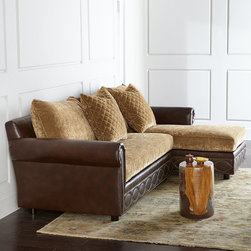 """Old Hickory Tannery - Jacinto Sectional Sofa - BROWN (RIGHT ARM FACING) - Old Hickory TanneryJacinto Sectional SofaDetailsWe love the way the nailhead trim on the front rail of this sectional complements the 2"""" diamond quilting on the throw pillows. Plush upholstery amps up the comfort factor.Hardwood frame.Upholstered in brown leather and cotton/acrylic/nylon.Springs are hand-tied to the frame and surrounding springs at eight points for lasting comfort and stability.Right-arm chaise. (A right-arm facing chaise will have the arm on your right as you face the chaise.)115""""W x 68.5""""D x 44.5""""T. Seat 18""""T; arms 26""""T.Made in the USA.Boxed weight approximately 275 lbs. Please note that this item may require additional delivery and processing charges.Designer About Old Hickory TanneryFounded more than 30 years ago Old Hickory Tannery is still family owned and operated in Hickory North Carolina. Although the company's name reflects its original focus on fine leather upholstery Old Hickory is now equally well know for fabric-covered seating. Its range of styles is impressive from dramatic Duncan-Phyfe-style sofas to graceful Queen Anne armchairs claw-footed tub chairs feminine full-skirted settees and sleek slipper chairs. Old Hickory's craftsmen bring an abundance of expertise to their work; some have been making furniture for almost half a century. All upholstery is cut and sewn entirely by hand all frames are solid hardwood nailhead trim is hand-hammered and all springs are hand-tied to the frame and surrounding springs at eight points for lasting comfort and stability. These are just a few of the reasons why this American furniture maker is one of our favorites."""