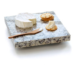 "Sea Stones - Cheese Board - Our Granite Food Server is a solid piece of granite collected from New England fabricators who provide the stones in a stunning range of colors and patterns, with no two identical. We hand cut and finish each slab to a size that is both comfortable to carry and convenient to use. They are ideal for use as a hot plate (trivet), a cold plate for your cheeses, appetizers, fruits, sushi, cookie and pie coolers, a cutting board, or even as a handsome and safe candle stand. Thick foam feet both protect your furniture and leave plenty of space for easy lifting. Additionally, the Granite Food Server comes with a solid cherry knife/spreader that has been hand crafted in the USA and is secured with raffia for gift giving. Pre-chill in fridge or freezer to keep foods cold, or warm in ovens up to 120°F to keep things warm. Hand wash with soap and water. 10""x10""x1.25"", 12 lbs. Granite color will vary."
