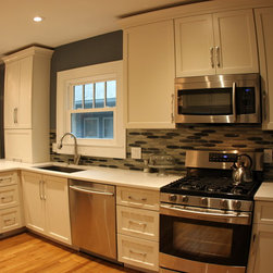 Traditional clean lined white kitchen -
