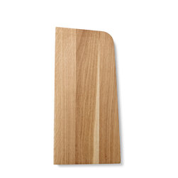 Menu - Tilt Cutting Board, Large - Tilt Cutting Board is designed with a special angle on its sides in order for it to lean steadily against your kitchen wall. A clever detail that spares you the agony of cuts in the table top and loud slams of cutting boards hitting the table, while also adding a beautiful new dimension to the overall shape of the board - simple and straight lines broken by the soft iconic corners and perfectly angled sides. The cutting board is made of solid oak, treated with oil.