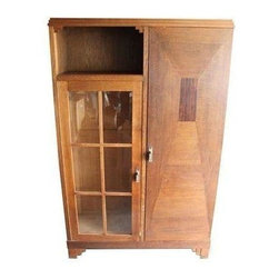 Pre-owned French Arts & Crafts Oak & Macassar Libraries - Beautiful French oak library pair with beveled glass door on one side and multiple adjustable shelves in the cabinet side. Macassar wood inlay on each cabinet. Feet have stepped detail, typical of the Art Deco period. The library comes with adjustable shelves and is great for storage. The second library is a mirror image of the first. This pair is in Los Angeles and available for local delivery.