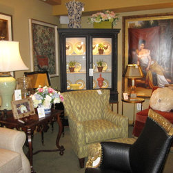 Photos from our furniture gallery at European Home - Original oil painting from the John Richards collection, lighted display cabinet in a great rubbed through black finish, with cement gray interior, transitional chair and classic Theodore Alexander lamp, ceramic and brass