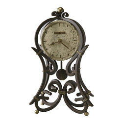 Howard Miller - Howard Miller Vercelli Quartz Mantel Clock - Howard Miller - Mantel / Table Clocks - 635141 - This contemporary mantel clock is a unique accent and a means of fostering a certain charm in your living space. Distinguished by its decorative wrought-iron scroll work cast crown and polystone dial the Vercelli has a particular charm to it. An aged ironstone pendulum and aged spade hands join the reliable timekeeping of quartz movement to complete the look and appeal of the Vercelli Quartz Mantel Clock.