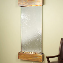 """Glass and Mirrored Wall Water Features - The Inspiration Falls Mirrored - The Inspiration Falls Wall Fountain with Glass Face is a wonderful purchase and you can feel good about your purchase with a 100% money back guarantee. All of our wall fountains like the Inspiration Falls come with a one year warranty. To absolutely assure the lowest price we are proud to offer a price match guarantee on any competitor's price. Using the Inspiration Falls interior waterfall in your home or office will give the room a great relaxing feeling, and a life like """"at one with nature"""" atmosphere. The natural stone face compliments the powder coat finished frame to create an earthy, rustic feel. This wall water feature is a great way to create a peaceful environment and will serve as the visual center-point in any space."""
