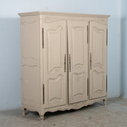 Armoire - This lovely 3-door French armoire has been given new life with a recent painted soft gray/white finish adding a romantic feel to the piece. Note the great interior storage with hanging rods on the left and right, and shelves with pull out drawers in the center. While it exudes grace and charm, this piece is highly functional as well.