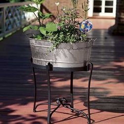 Galvanized Planter and Stand - I'm a big fan of galvanized tubs. Every time I see one I think of great summer parties my parents had when I was a kid. on top of being a great entertaining accessory, they're a great looking used as planters.