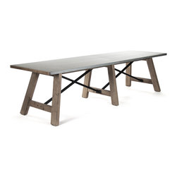 Kathy Kuo Home - Calistoga Industrial Rustic Galvanized Steel 12 Person Dining Table - Gather the whole gang around this extra large industrial dining room table. The solid oak and iron trestle base offer ample legroom and support the gorgeous galvanized steel tabletop, finished in acid-washed zinc for a uniquely rustic look. Complete the ensemble with our Calistoga Washed Canvas Dining Chairs for an inviting, stylish setting.