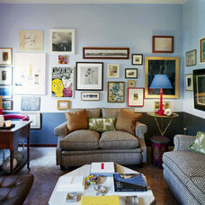 Eclectic  Living room with blue walls and pictures/posters