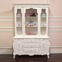 Elegant Shabby Rose Glass China Cabinet - This gorgeous china cabinet features a central glass door on the top hutch. The lower half has three central drawers and two side cabinets. It has been adorned with our beautiful rose appliques and glass knobs.