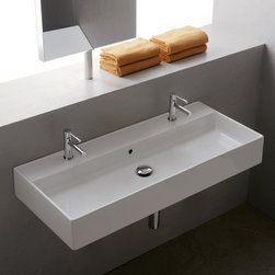Scarabeo - Rectangular White Ceramic Wall Mounted or Vessel Sink - Contemporary style rectangular white ceramic sink. Sleek wall mounted or vessel sink with overflow. Available with no hole, one hole, two hole, or three hole. Made in Italy by Scarabeo. Rectangular ceramic sink. Wall mounted or above counter with overflow. No hole, one hole, two hole, or three hole available. First picture shown refers to inch two hole inch , second picture shown refers to inch one hole inch. Faucets are 16 inches apart with inch two hole inch option. Note: technical specification picture is in millimeters. From the Scarabeo Teorema Collection. ADA compliant. Standard drain size of 1.25 inches. Because the sink has multiple installations, the back side is not glazed.