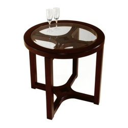 Magnussen T1020 Juniper Wood Round End Table - With a mesmerizing design and enchanting color, the Magnussen T1020 Juniper Wood Round End Table makes a handsome companion to your leather recliner or as an accent table in an empty corner. Made from hardwood solids, this piece features a handsome mink brown finish and a clear beveled glass top that accentuates the piece's crosshair design. This traditional-style piece is the perfect choice for your new living room or den.About Magnussen FurnitureFrom its beginning as a small furniture company in Ontario, Canada, Magnussen Furniture has evolved into a full-line furniture resource with offices in Canada, the United States, and the Far East. Their business is creating furniture designs of exceptional style, value, and beauty. They produce these designs in partnership with manufacturing partners around the world that meet exacting standards for superior quality at the best possible value.