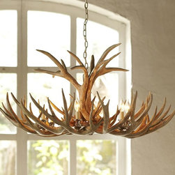 Faux Antler Chandelier - The antler theme can be carried through in a gorgeous chandelier. This rustic piece can be incorporated into a modern space or a ski vacation retreat.