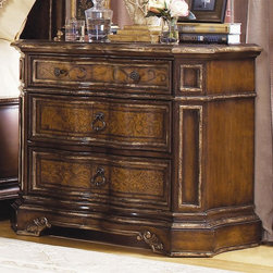Hooker Furniture - Beladora Nightstand - Three drawers. Made from hardwood solids with maple, olive ash burl and walnut veneers with resin accents. Caramel finish with gold tipping. Mid and bottom drawer (max width): 14.50 in.. Mid and bottom drawer (min width): 23.88 in. L x 13.50 in. W x 6.13 in. H. Top drawer (max width): 14.50 in.. Top drawer (min width): 23.88 in. L x 13.50 in. W x 3.563 in. H. Overall: 36 in. W x 19 in. D x 30 in. HThe 70-piece Beladora collection of bedroom, dining, living room tables, home office and home entertainment furniture is the epitome of the grand European elegance many are looking for. Enrich you surroundings with the grand European elegance of Beladora. If you appreciate traditional forms, exquisite shapes, graceful curves and artistic hand work, the Beladora office collection by Hooker Furniture will inspire you as you work in your personal office space. The collection is dramatic and graciously scaled with maple and olive ash burl veneers accented by distinctive walnut inlays. Beladora pays homage to costly Old World antiques and showcases its exceptional design with a refined caramel finish with subtle gold tipping to accent the carving, chiseling and marquetry work all done by the hands of skilled craftsmen.