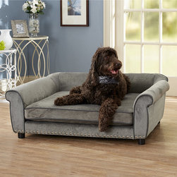 Frontgate - Outlaw Bed Dog Bed - Measuring 4' long, dog bed easily accommodates pets up to 100 lbs.. Solid wood frame for maximum strength and durability. Ultra plush upholstery is accented with faux leather welting and hand applied silver nail head. Orthopedic memory foam cushion relieves aging joints and bones. Cylinder legs elevate bed to avoid drafts while pet sleeps. Fashioned as a sofa-style bed, the Outlaw Pet Bed complements decor and provides dogs with lounging comfort. Durable wood frame, orthopedic memory foam, and low profile arms indulge pets and offer relief to aging joints. Measuring 4' long, dog bed easily accommodates pets up to 100 lbs. .  .  .  .  . Low profile arms for pets that love to lean . Storage pocket for toys and accessories . Seat cover unzips for easy washing . Made in USA.